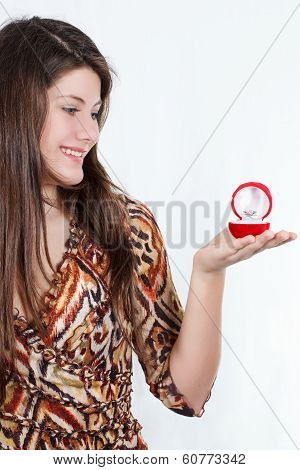 the portrait of beautiful girl with a ring in hands