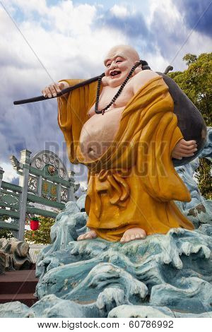 Ho Tai Laughing Buddha Statue At Haw Par Villa
