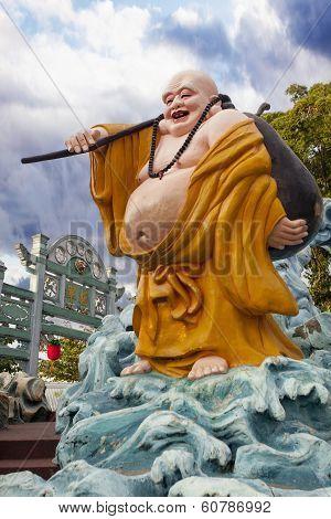 Ho Tai Laughing Buddha Statue At Haw Par Villa