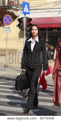 Businesswoman Crossing The Street