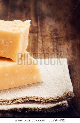 Gourmet Parmesan Cheese On Wooden Background Close Up. Piece Of Parmigiano  Cheese On A Napkin, Macr