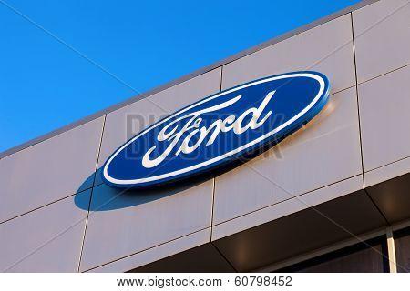 Samara, Russia - November 24, 2013: The Emblem Ford On The Office Of Official Dealer. Ford Motor Com