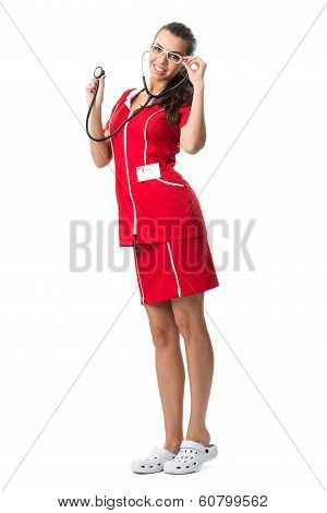 Pretty spectacled women doctor with stetoscope in red dress