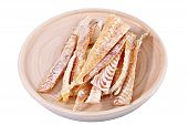 stock photo of flounder  - Slices of stockfish on wooden plate - JPG