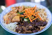 foto of rice noodles  - Traditional bowl of Vietnamese bun vermicelli rice stick noodle salad with charbroiled meat - JPG