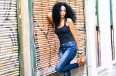 pic of black heel  - Portrait of a young black woman model of fashion wearing high heels in urban background