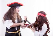 image of jack-in-the-box  - Two pirates fighting for box of tresure studio shooting - JPG