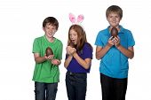 picture of niece  - three young children playing with large chocolate easter eggs - JPG