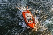 stock photo of coast guard  - Orange and white coast guard lifeboard photographed from bird - JPG