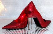 stock photo of stiletto heels  - An image of red stiletto heels with a silver back ground - JPG