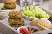 stock photo of veggie burger  - Vegan burgers with chickpeas served with fresh vegetables - JPG
