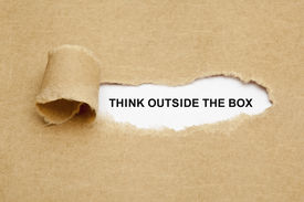foto of thinking outside box  - Think Outside The Box appearing behind torn brown paper - JPG