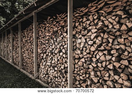 Stockpile of sawed logs under shed