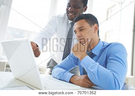 African-american businessman explaining new project to his colleague in office