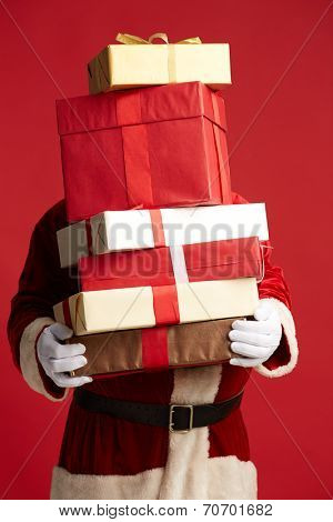 Santa Claus holding pile of giftboxes in isolation