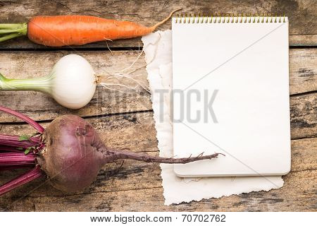 Empty Recipe Card  On Wooden Rustic Background With Fresh Vegetables.