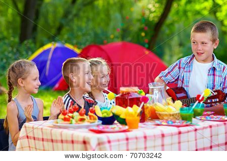 Happy Kids Around Summer Picnic Table