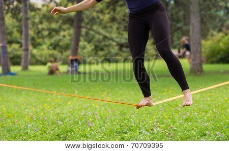 Slack line in the city park.