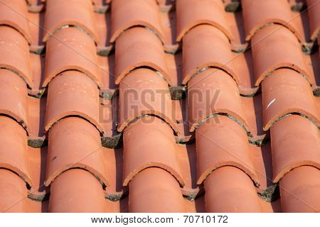 Construction detail of a red tile roof