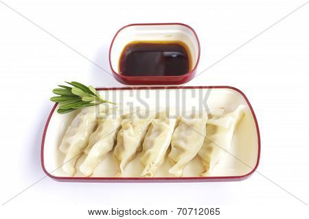 Plate Of Steamed Dumplings With Soy Sauce