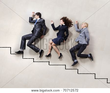 Funny businesspeople lying on floor and acting like running