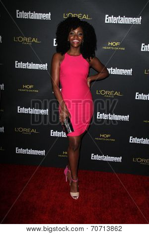 LOS ANGELES - AUG 23:  Teyonah Parris at the 2014 Entertainment Weekly Pre-Emmy Party at Fig & Olive on August 23, 2014 in West Hollywood, CA