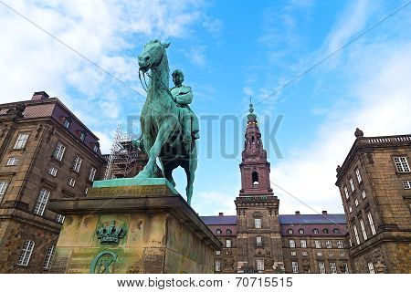 Christiansborg Castle and the Equestrian statue of King Christian IX in the center of Copenhagen Den
