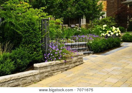 Landscaped  Garden And Stone Paved Driveway