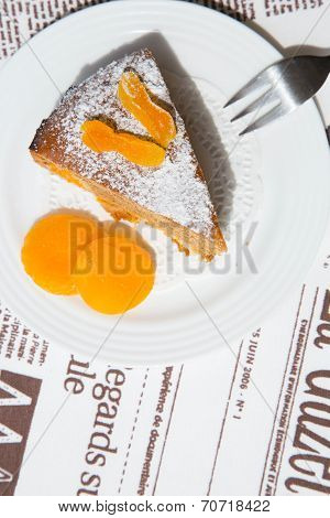 A Piece Of Homemade Apricot Pie On The White Plate