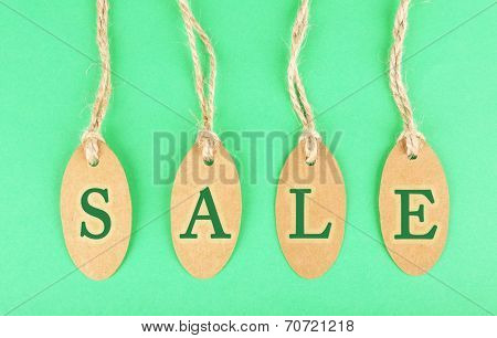 Sale tags on green background