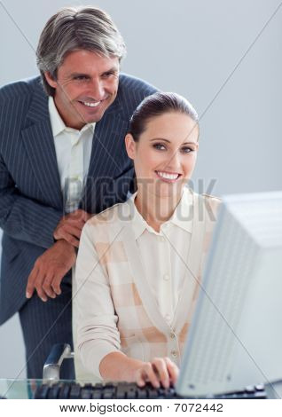 Portrait Of A Businesswoman And Her Manager Working At A Computer