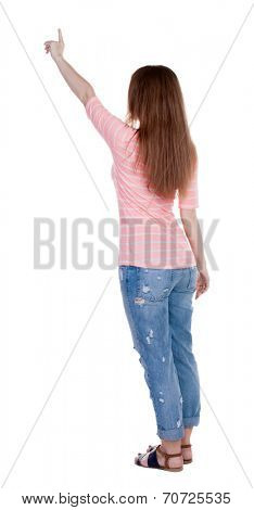 Back view pointing woman. beautiful redhaired  girl .Rear view people collection.  backside view person.  Isolated over white background. Girl in white T-shirt points a finger at something interesting