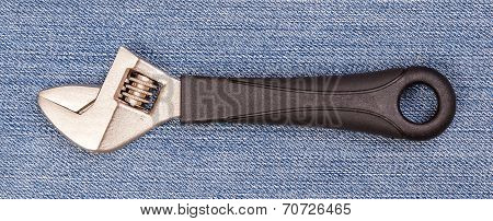 Pliers Black Handle Tool Isolated On Blue Jeans Background