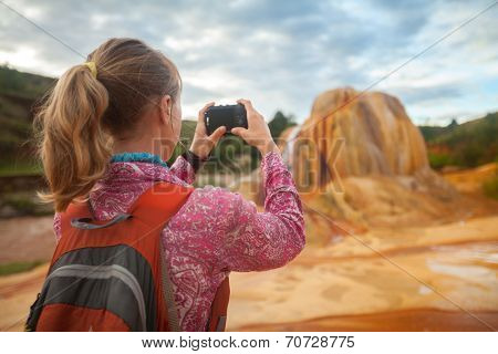 Tourist taking picture of the limestone structure of Analavory geysers. Madagascar