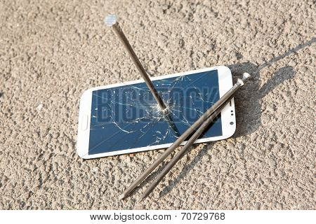 Composition of metal nail and smartphone