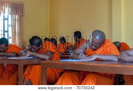 Monks study in a class