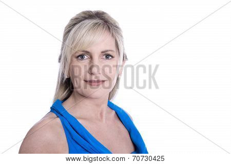 Isolated Face Of A Beautiful Middle Aged Blond Woman In Blue Shirt.