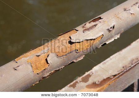 Rust And Peeling Paint On Metal Bar
