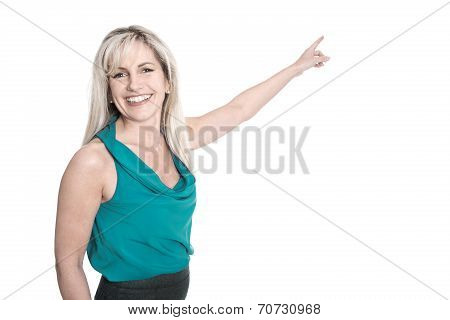 Isolated Smiling Woman In Green Shirt Pointing At White.