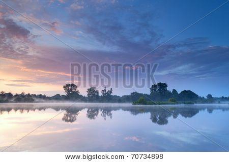 Misty Sunrise On River