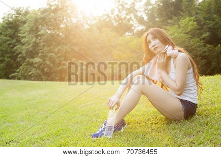 Woman Sitting Rest After Exercise.