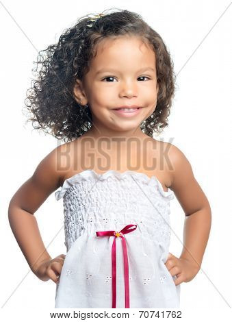 Joyful little girl with an afro hairstyle eating a chocolate cookie isolated on white