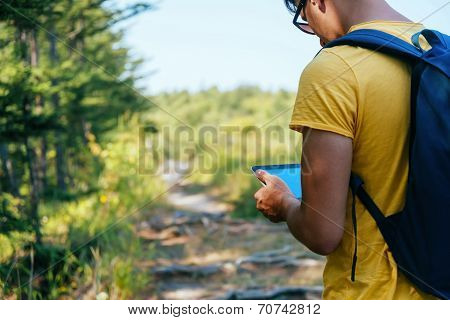 Hiker Man With Tablet Pc