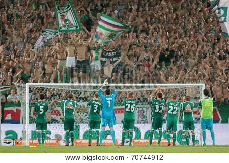 VIENNA, AUSTRIA - AUGUST 8 The team of SK Rapid celebrates the victory at a UEFA Europa League game on August 8, 2013 in Vienna, Austria.
