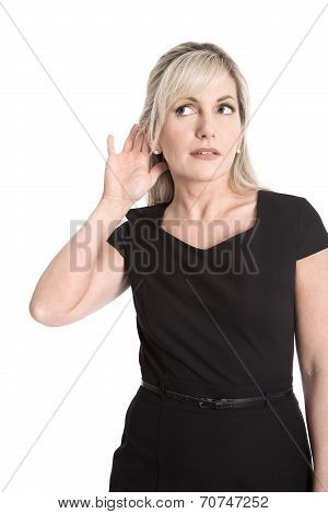 Isolated Business Woman In Black Dress Listening With Hearing Aid.