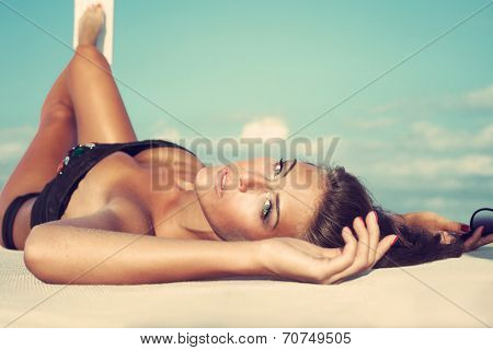 beauty shot of young woman on the beach