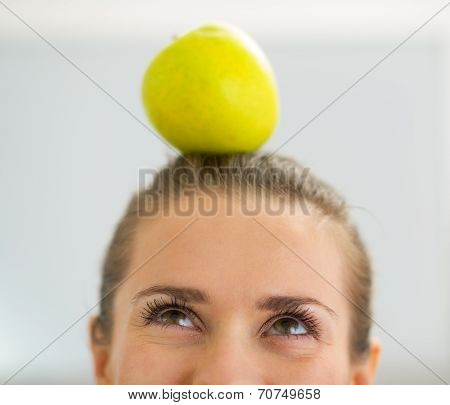 Closeup On Young Woman With Apple On Head