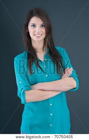 Portrait Of A Young Brunette Pretty Girl In A Green Blouse.