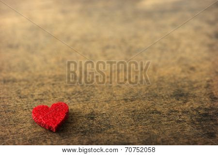 Heart on a old rustic wooden surface. plenty of copy space.