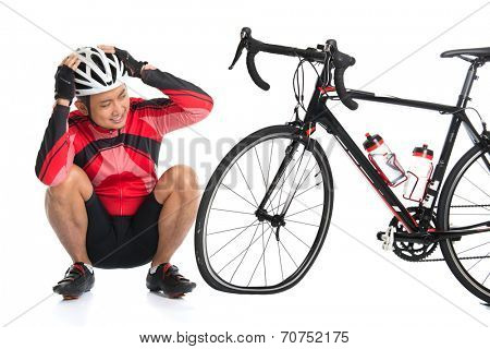 Asian cyclist headache and looking at his flat tire bike, isolated on white background.